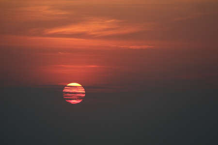 dark sunset back on silhouette red orange evening cloud and sky over horizon sea Imagens