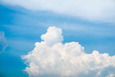 white huge heap cloud sunshine in summer blue sky soft cloud background