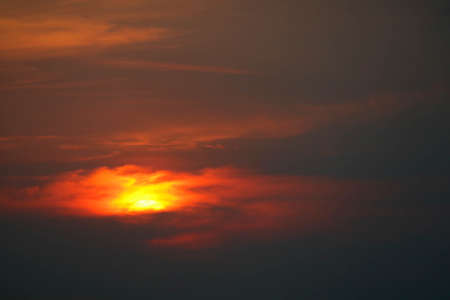 dark sunset back on silhouette red orange evening cloud and sky Imagens