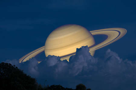 Saturn on night sky back silhouette mountain and heap cloud Reklamní fotografie