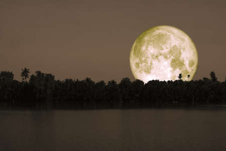 full cold moon back on mountain and reflection on river in the night sky