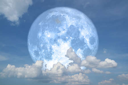 blue strawberry moon back on silhouette heap cloud on night sky