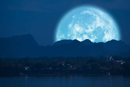 full Beaver Moon back on mountain and reflection on river in the night sky Reklamní fotografie