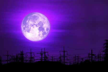 full milk moon purple back on silhouette electric pole on night sky Archivio Fotografico - 134350086