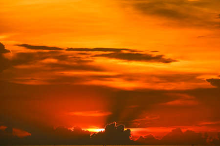 sunset back on last light red and orange sky silhouette cloud