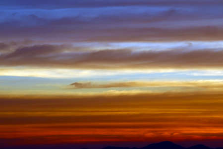 the rainbow and blue sky red orange yellow cloud in sunset on the mountain