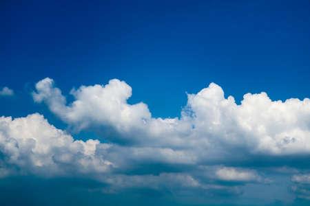 white pure heap cloud sunshine in the blue sky soft sunlight