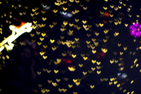 bokeh and blur abstract heart shape love valentine colorful decorate night light on wall at shopping mall