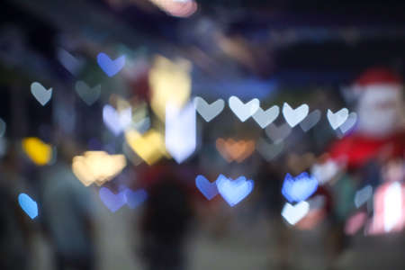 abstract blur and bokeh heart shape love valentine colorful night light of shopping mall