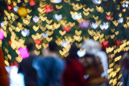 blur people selfie with heart shape love valentine colorful night light of shopping mall