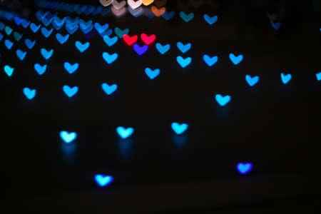 aqua colorful bokeh and blur heart shape love valentine day night light on floor Imagens