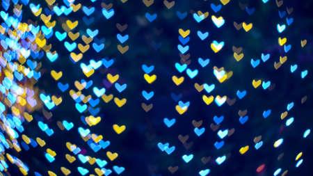 blur heart shape love valentine day on tree in garden night light cold tone Imagens
