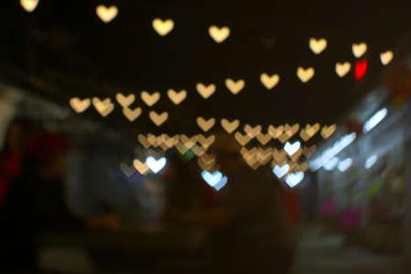 imgae of bokeh and blur line heart shape love valentine day night light in the garden vintage tone Imagens