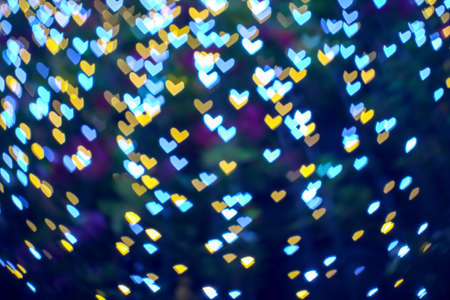 abstract blur bokeh heart shape love valentine day on tree in garden night light