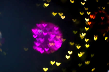 magenta ball abstract bokeh and blur heart shape love valentines day colorful night light Imagens