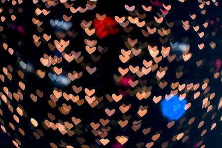 abstract bokeh and blur heart shape love valentine colorful night light on wall at shopping mall Imagens