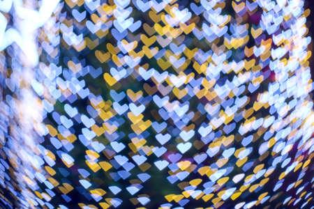 abstract blur blue white heart shape love valentine day on tree in garden night light