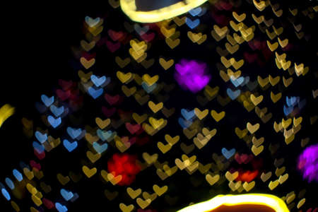purple ball abstract bokeh and blur heart shape love valentine colorful night light on wall at shopping mall Imagens