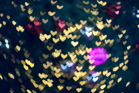 blur and bokeh heart shape love valentine colorful night light at shopping mall Imagens