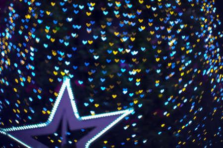 blur heart shape love on tree in garden night light cold tone Imagens