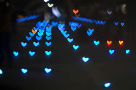 light blue bokeh and blur heart shape love valentine colorful night light on floor at shopping mall