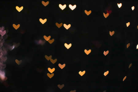 gold bokeh and blur heart shape love valentine day colorful night light on tree