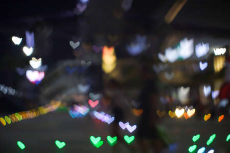 green bokeh and blur heart shape love valentine day colorful night light on floor