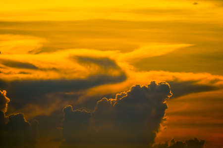 sunset orange cloud back on dark silhouette sky and red flame cloud background