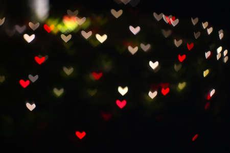 gold red and blur heart shape love valentine day colorful night light in the garden