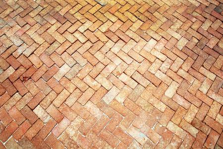 Ancient of pattern light tone brick floor pavement stones on walkway