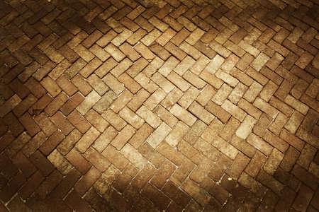 Ancient of pattern dark and light brown tone brick floor pavement stones on walkway