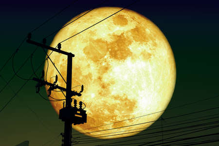 Super Harvest moon back silhouette power electric line on night sky,
