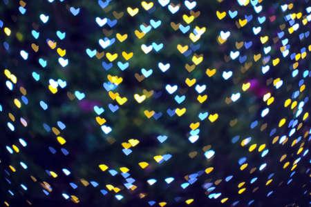 blur heart shape love valentine day on tree in garden night light cold tone 版權商用圖片