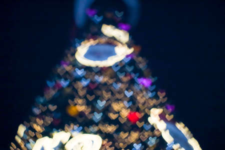blur and bokeh heart shape love of valentine day night light at shopping mall