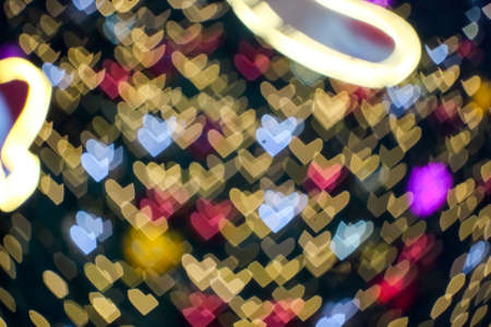 blur and bokeh heart shape love valentine colorful night light in front of shopping mall