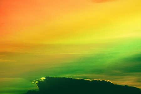 multicolor heap giant orange sunset cloud and dark sky background 版權商用圖片