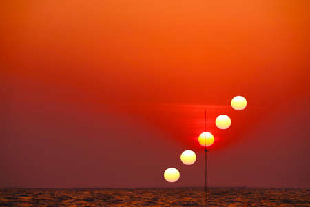 incredible light red orange yellow sky sunset silhouette flag in the sea