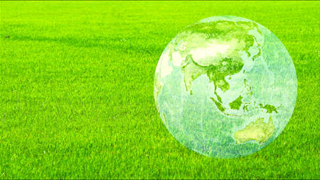 earth and asia map on the green field, save environment, ecology afforestation, climate change concept