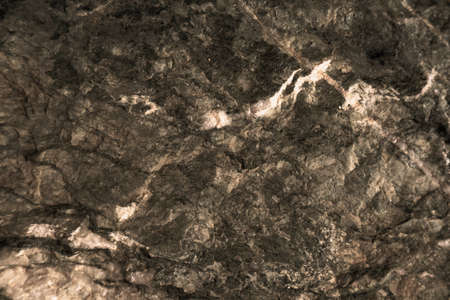 ancient rust copper granite stone surface of cave for interior wallpaper and background 版權商用圖片