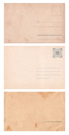 Set of three empty postcards isolated on white  photo