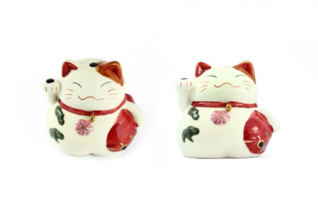 Maneki neko ( japanese fortune cat ) isolated on white photo