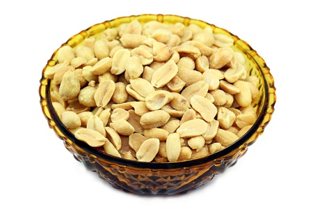 Salted peanuts in a bowl isolated on white