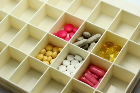 pill box: Various types of pills in a pill box Stock Photo