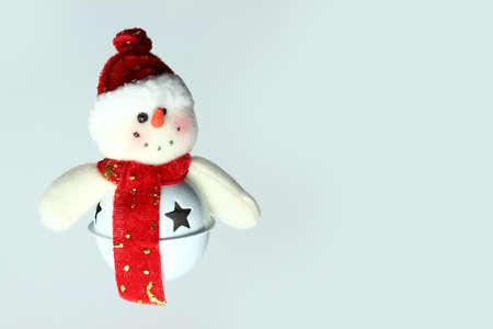 Little snowman ornament on blue background Stock Photo