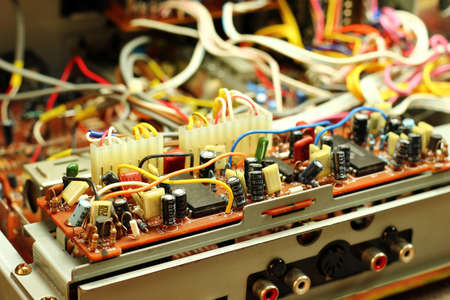 capacitors: Microchips, wires and capacitors inside device Stock Photo