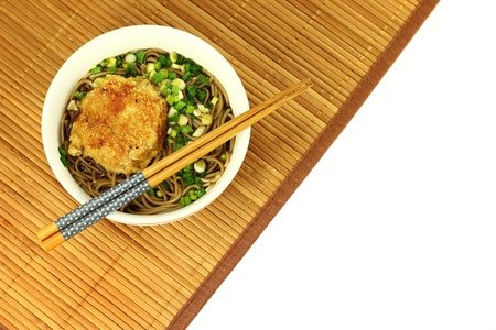 Japanese korokke soba on bamboo mat. Empty space for text.