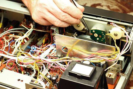 Hands repairing device. Stock Photo