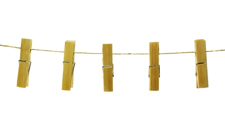 Clothes pins on rope, isolated on white Stock Photo