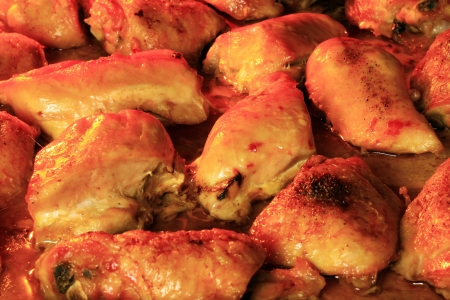 Chicken thighs being cooked inside oven