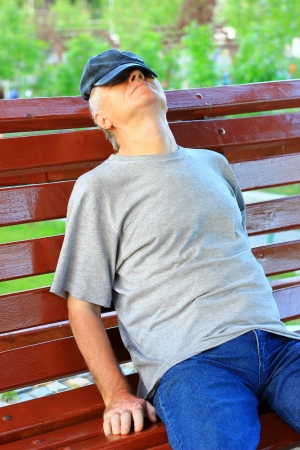Man sleeping on a bench photo